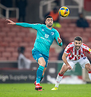 2nd January 2021; Bet365 Stadium, Stoke, Staffordshire, England; English Football League Championship Football, Stoke City versus Bournemouth; Lewis Cook of Bournemouth with his eye on the ball