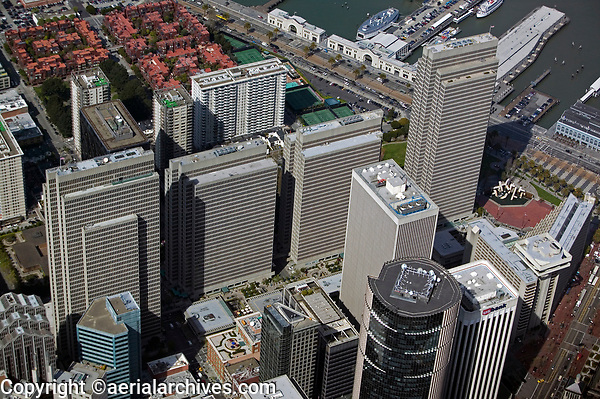 aerial photograph of the Embarcadero Center, San Francisco, California; high rises in the foreground include 100 California Street and 101 California Street; Pier 3 and Pier 5 are visible in the background