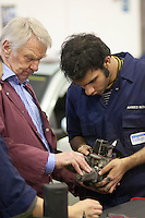 Instructor advising student, Motor Mechanics, Further Education College.