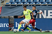 FOXBOROUGH, MA - MAY 12: Nick Firmino #10 of Union Omaha passes the ball as Jake Rozhansky #32 of New England Revolution II pressures during a game between Union Omaha and New England Revolution II at Gillette Stadium on May 12, 2021 in Foxborough, Massachusetts.