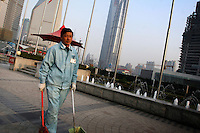 CHINA. Shanghai. A street cleaner. Shanghai is a sprawling metropolis or 15 million people situated in south-east China. It is regarded as the country's showcase in development and modernity in modern China. This rapid development and modernization, never seen before on such a scale has however spawned countless environmental and social problems. 2008.