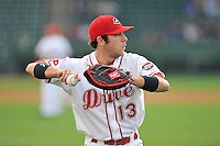 Catcher Austin Rei (13) of the Greenville Drive warms up before a game against the Charleston RiverDogs on Tuesday, May 17, 2016, at Fluor Field at the West End in Greenville, South Carolina. Greenville won, 4-2. (Tom Priddy/Four Seam Images)