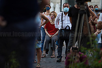 """Sonia Bergamasco (Actress).<br /> <br /> Rome, 27/07/2020. Today, hundreds of people, NGO's (ONG) representatives, actors and politicians gathered in Piazza San Silvestro (near the Italian Parliament) to protest (1.) against the dramatic situation in Libya - erupted in a civil war between the GNA (2.) and the forces of General Khalifa Belqasim Haftar - and to protest against the inhumane conditions of migrant people trapped in legal and illegal prisons in Libya. The aim of the demo was to call the Italian Government to stop funding the """"Libyan Coast Guard"""" and to immediately help and free People in Libya throughout """"Humanitarian Corridors"""", and give them the protection they are entitled of by the International Human Rights Conventions. <br /> From the organisers Facebook event page: «[…] we meet to ask the Italian Government and the European States to stop funding the so-called Libyan coast guard, to close and evacuate the detention centres by transferring migrants out of Libya and to promote corridors to help people on the run find protection without endangering their lives. The men, women and children who take the sea from the Libyan coast flee from situations of extreme misery, despotic regimes, tribal persecutions, ethnic conflicts, wars and environmental catastrophes. And in Libya they are subjected to violence, extortion, detention, torture, rape and torture. A few days ago, on July 16, the Chamber of Deputies [Of the Italian Parliament, ndr] for the fourth consecutive year approved the financing of the Italian mission in Libya, which provides financial support for the so-called Libyan coastguard and training and training of its members. […] The mobilization will be accompanied by readings by Ascanio Celestini, Valentina Carnelutti, Fabrizio Gifuni and Sonia Bergamasco […]».<br /> <br /> Footnotes & Links:<br /> 1. https://www.facebook.com/events/2732849460337428/<br /> 2. 07.05.19 Prime Minister of Libya Fayez al-Serraj Met Italian PM Giuseppe Conte at Palazz"""