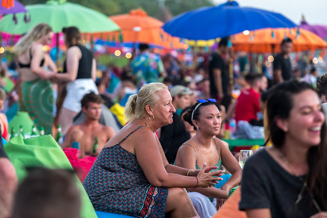 6 DECEMBER, 2019 BALI, INDONESIA: Helen Bibi from Melbourne relaxes into a beanbag at Seminyak bar, La Plancha for sunset cocktails on Masari Beach, Seminyak in Bali. There has been a levelling out of Australian tourist numbers to Bali in recent times and tastes are changing regarding what people want from their holiday. Picture by Graham Crouch/The Australian