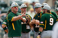 Baylor Bears head coach Steve Smith #XX signals to his bullpen during the NCAA Regional baseball game against Oral Roberts University on June 3, 2012 at Baylor Ball Park in Waco, Texas. Baylor defeated Oral Roberts 5-2. (Andrew Woolley/Four Seam Images)