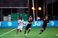 LAKE BUENA VISTA, FL - JULY 14: Lewis Morgan #7 of Inter Miami dribbles the ball during a game between Inter Miami CF and Philadelphia Union at Wide World of Sports on July 14, 2020 in Lake Buena Vista, Florida.