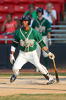 Rand Smith #21 of the Greensboro Grasshoppers follows through on his swing against the Hickory Crawdads at  L.P. Frans Stadium July 10, 2010, in Hickory, North Carolina.  Photo by Brian Westerholt / Four Seam Images
