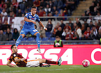 Calcio, Serie A: Roma vs Empoli. Roma, stadio Olimpico, 17 ottobre 2017.<br /> Empoli's Rade Krunic is tackled by Roma's Kostas Manolas, bottom, during the Italian Serie A football match between Roma and Empoli at Rome's Olympic stadium, 17 October 2015.<br /> UPDATE IMAGES PRESS/Isabella Bonotto