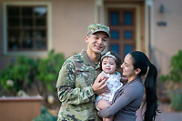 Happy US Army soldier, his wife and daughter, outside home, model-released, stock photo, DoD compliant, for sale, for advertising