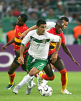 Zinha (7) of Mexico slips through the Angolan defense. Mexico and Angola played to a 0-0 tie in their FIFA World Cup Group D match at FIFA World Cup Stadium, Hanover, Germany, June 16, 2006.