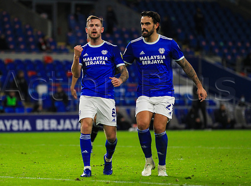 3rd November 2020; Cardiff City Stadium, Cardiff, Glamorgan, Wales; English Football League Championship Football, Cardiff City versus Barnsley; Joe Ralls of Cardiff City celebrates with Sean Morrison of Cardiff City after scoring his sides second goal in the 45+1 minute from the penalty spot