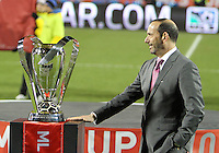 Commissioner Don Garber looks at the trophy During post game trophy Celebration after MLS Cup 2010 at BMO Stadium in Toronto, Ontario on November 21 2010.