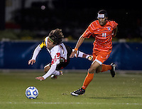 Tsubasa Endoh (31) of Maryland is fouled by Amadou Dia (11) of Clemson during the ACC tournament semifinals at the Maryland SoccerPlex in Boyds, MD.  Maryland defeated Clemson, 1-0, in overtime.