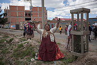 An indigenous woman complains during clashes between supporters of Bolivian ex-President Evo Morales and security forces in El Alto, on the outskirts of La Paz, Bolivia. Morales's backers have taken to the streets demanding the resignation of auto-proclaimed president Jeanine Añez and the return of Morales who resigned on Nov. 10 under pressure from the military after weeks of protests against him over a disputed election that he claimed to have won. November 19, 2019.<br /> Une femme indigène se plaint lors d'affrontements entre des partisans de l'ancien président bolivien Evo Morales et les forces de sécurité à El Alto, dans la banlieue de La Paz, en Bolivie. Les partisans de Morales sont descendus dans la rue pour exiger la démission du président autoproclamé Jeanine Añez et le retour de Morales qui a démissionné le 10 novembre sous la pression des militaires après des semaines de protestations contre lui suite à une élection contestée qu'il prétend avoir gagnée. 19 novembre 2019.