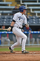 Asheville Tourists third baseman Ryan McMahon #5 swings at a pitch during a game against the Greenville Drive at McCormick Field on May 18, 2014 in Asheville, North Carolina. The Tourists defeated the Drive 3-1. (Tony Farlow/Four Seam Images)