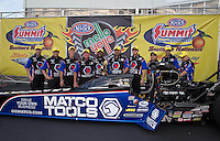 May 11, 2013; Commerce, GA, USA: NHRA top fuel dragster driver Antron Brown celebrates with crew after winning the Southern Nationals at Atlanta Dragway. Mandatory Credit: Mark J. Rebilas-