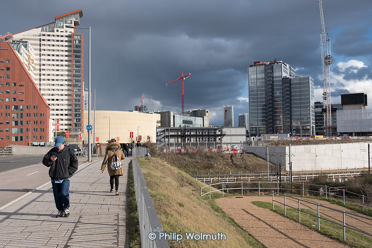 Cranes and high rise office and residential blocks, Queen Elizabeth Olympic Park, Stratford.