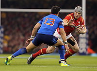 Jonathan Davies of Wales (R) against Maxime Mermoz of France (L) the Wales v France, 2016 RBS 6 Nations Championship, at the Principality Stadium, Cardiff, Wales, UK