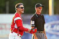 Batavia Muckdogs manager Dann Bilardello #11 jokes with umpire Don Rock during an exhibition game against the Newark Pilots of the Perfect Game Collegiate Baseball Lague at Dwyer Stadium on June 15, 2012 in Batavia, New York.  Batavia defeated Newark 8-0.  (Mike Janes/Four Seam Images)