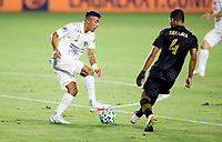CARSON, CA - SEPTEMBER 06: Julian Araujo #22 of the Los Angeles Galaxy moves with the ball during a game between Los Angeles FC and Los Angeles Galaxy at Dignity Health Sports Park on September 06, 2020 in Carson, California.