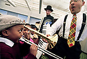 """story: Jazz.date: 4-8-02.caption: Delfeayo Marsalis gives a hand to 6 year old Emari Tabb of Detroit trying to play Marsalis' trombone after performing """"Jazz and Jazmine Meet the Jazz Band, an original work by Marsalis designed to introduce children ages 3-8 to Jazz by way of a puupet show. Emari Tabb said after trying Marsalis' trombone....""""I play the drums too.""""  The show took place at Focus:HOPE Conference Center on Oakman in Detroit on Monday April 8."""