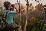 Birdwatcher / wildlife watcher on canopy walkway. Danum Valley, Sabah, Borneo.