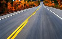 Canada,Alberta, Banff National Park. Road in fall blur action