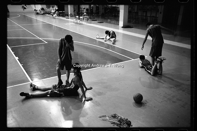 Basketball players of Dongguan Guangming Middle School in Dongguan, Guangdong province, take part in a training session, November 2011.