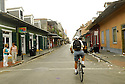 Richard Campanella, associate director for Geographical Analysis, cycles down Bourbon street in New Orleans while tracking the return of businesses on some main commercial streets, Sunday, July 30, 2006..(Cheryl Gerber for New York Times)..