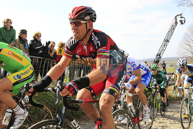The peloton including Thor Hushovd (NOR) BMC Racing Team climbs Koppenberg during the 96th edition of The Tour of Flanders 2012, running 256.9km from Bruges to Oudenaarde, Belgium. 1st April 2012. <br /> (Photo by Eoin Clarke/NEWSFILE).