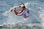 Female Surfer, U.S. Open Surfing Competition, August 2011 - Huntington Beach, California. Photograph by Alan Mahood.