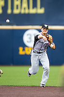 Oakland Golden Grizzlies shortstop Mike Brosseau (10) makes a throw to first base against the Michigan Wolverines on May 17, 2016 at Ray Fisher Stadium in Ann Arbor, Michigan. Oakland defeated Michigan 6-5 in 10 innings. (Andrew Woolley/Four Seam Images)