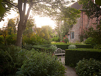 Harold Nicolson, Vita's husband, reconfigured the chaotic garden they inherited, measuring it out in footsteps and imposing a grid system of 'rooms', consisting of square spaces enclosed by box hedges and connected by brick pathways