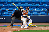 Canisius College Golden Griffins shortstop Anthony Massicci (7) at bat in front of catcher Harrison Wenson (7) and umpire Robert Lothian during the first game of a doubleheader against the Michigan Wolverines on February 20, 2016 at Tradition Field in St. Lucie, Florida.  Michigan defeated Canisius 6-2.  (Mike Janes/Four Seam Images)