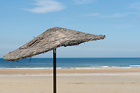 a basic parasol on a sandy beach