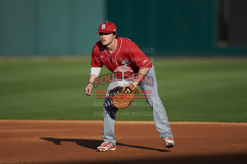 North Carolina State Wolfpack first baseman Preston Palmeiro (12) on defense against the Charlotte 49ers at BB&T Ballpark on March 29, 2016 in Charlotte, North Carolina. The Wolfpack defeated the 49ers 7-1.  (Brian Westerholt/Four Seam Images)
