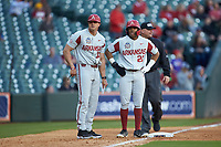 Christian Franklin (25) of the Arkansas Razorbacks stands on third base next to third base coach Nate Thompson (30) during the game against the Oklahoma Sooners in game two of the 2020 Shriners Hospitals for Children College Classic at Minute Maid Park on February 28, 2020 in Houston, Texas. The Sooners defeated the Razorbacks 6-3. (Brian Westerholt/Four Seam Images)