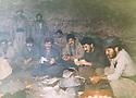 Iraq 1991.In february, after a long walk under the rain, Mahmoud Sangawy and his peshmergas resting in a cave  in Germian .Irak 1991 .En fevrier,apres une longue marche sous la pluie, Mahmoud Sangawy et ses peshmergas se rechauffent autour d'un feu dans une grotte du Germian