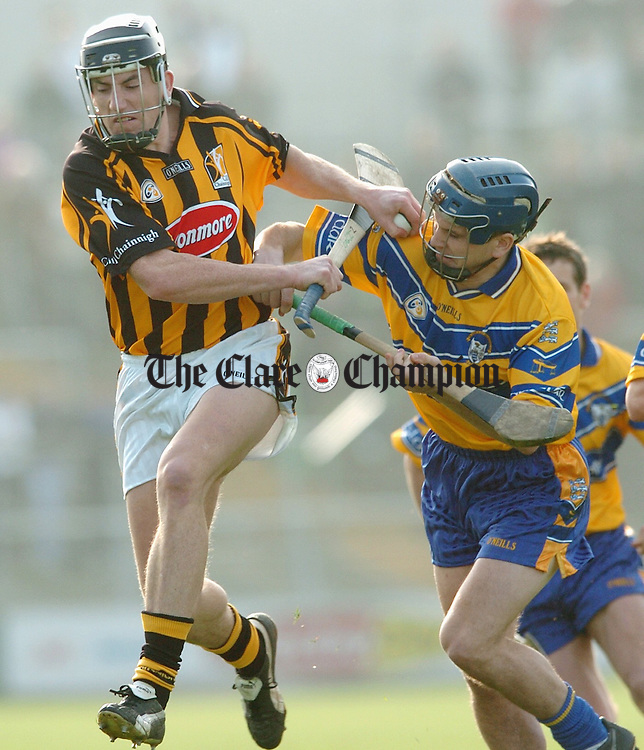 Gerry O Grady of Clare piles on the pessure on Kilkenny's Derek Lyng during the national league game in Nowlan park. Photograph by John Kelly.