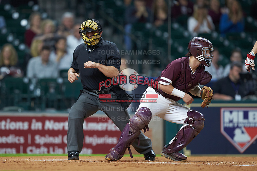 Home plate umpire John Schiller calls a batter out on strikes during the NCAA baseball game between the Mississippi State Bulldogs and the Louisiana Ragin' Cajuns in game three of the 2018 Shriners Hospitals for Children College Classic at Minute Maid Park on March 2, 2018 in Houston, Texas.  The Bulldogs defeated the Ragin' Cajuns 3-1.   (Brian Westerholt/Four Seam Images)