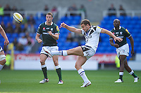 Olly Barkley of Bath Rugby kicks the ball upfield during the Aviva Premiership match between London Irish and Bath Rugby at the Madejski Stadium on Saturday 22nd September 2012 (Photo by Rob Munro)