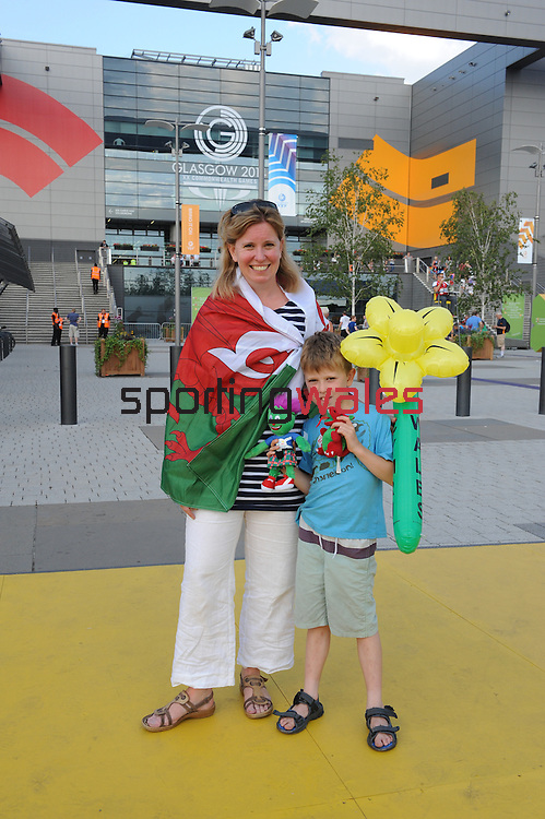 Welsh fans Fiona and Huw Williamgs who are wife and son to Wales rider Ieuan Williams who just won bronze in the 1000m tandem<br /> <br /> Photographer Ian Cook/Sportingwales<br /> <br /> 20th Commonwealth Games - Track Cycling -  Day 2 - Friday 25th July 2014 - Glasgow - UK