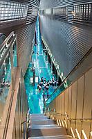 Singapore MRT Mass Rapid Transit Stadium Station. Students Waiting to Board Train.