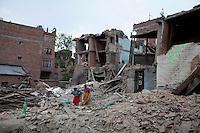 People work near collapsed houses following the earthquake in Bhaktapur, near Kathmandu, Nepal. May 7, 2015