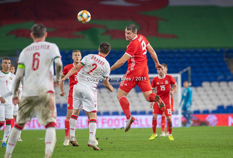 Cardiff - UK - 9th September :<br />Wales v Belarus Friendly match at Cardiff City Stadium.<br />Sam Vokes of Wales heads the ball above Stanislav Dragun in the second half.<br />Editorial use only