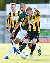 East Fife's Stevie Campbell holds off Hibs' Farid El Alagui.