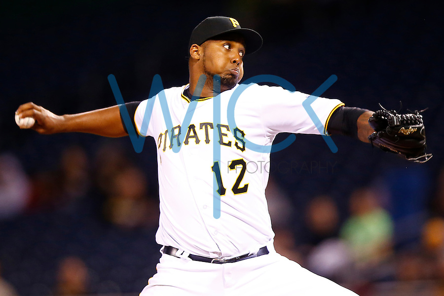 Juan Nicasio #12 of the Pittsburgh Pirates pitches against the St. Louis Cardinals during the game at PNC Park in Pittsburgh, Pennsylvania on April 6, 2016. (Photo by Jared Wickerham / DKPS)