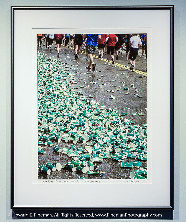"""""""In The Runners' Wake"""" was shot at the beginning of Heartbreak Hill in the 2010 Boston Marathon. Lots of empty cups of Poland Springs water and Gatorade. This print was included in the FOR ONE BOSTON art and writing portfolio box, with all sales proceeds going to One Fund Boston following the 2013 Marathon bombing."""