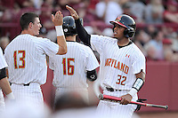 Catcher Kevin Martir (32) of the Maryland Terrapins celebrates after scoring a run in an NCAA Division I Baseball Regional Tournament game against the South Carolina Gamecocks on Saturday, May 31, 2014, at Carolina Stadium in Columbia, South Carolina. Maryland won, 4-3. (Tom Priddy/Four Seam Images)