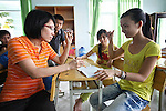 A woman teaches sign language to a girl who cannot hear or speak at a center for children who have been affected by dioxin exposure in the village of Hoa Nhon, near Da Nang, Vietnam. The Da Nang Association of Victims of Agent Orange/Dioxin says that more than 1,400 children around the city have mental or physical disabilities because of dioxin exposure, a legacy of the U.S. military's use of Agent Orange and other herbicides during the Vietnam War more than 40 years ago. About 60 children attend the Hoa Nhon center each day, where they are taught to read and write, sew clothes, make handicrafts and help their families raise crops and livestock. The Vietnam Red Cross estimates that 3 million Vietnamese suffer from illnesses related to dioxin exposure, including at least 150,000 people born with severe birth defects since the end of the war. The U.S. government is paying to clean up dioxin-contaminated soil at the Da Nang airport, which served as a major U.S. base during the conflict. But the U.S. government still denies that dioxin is to blame for widespread health problems in Vietnam and has never provided any money specifically to help the country's Agent Orange victims. May 29, 2012.